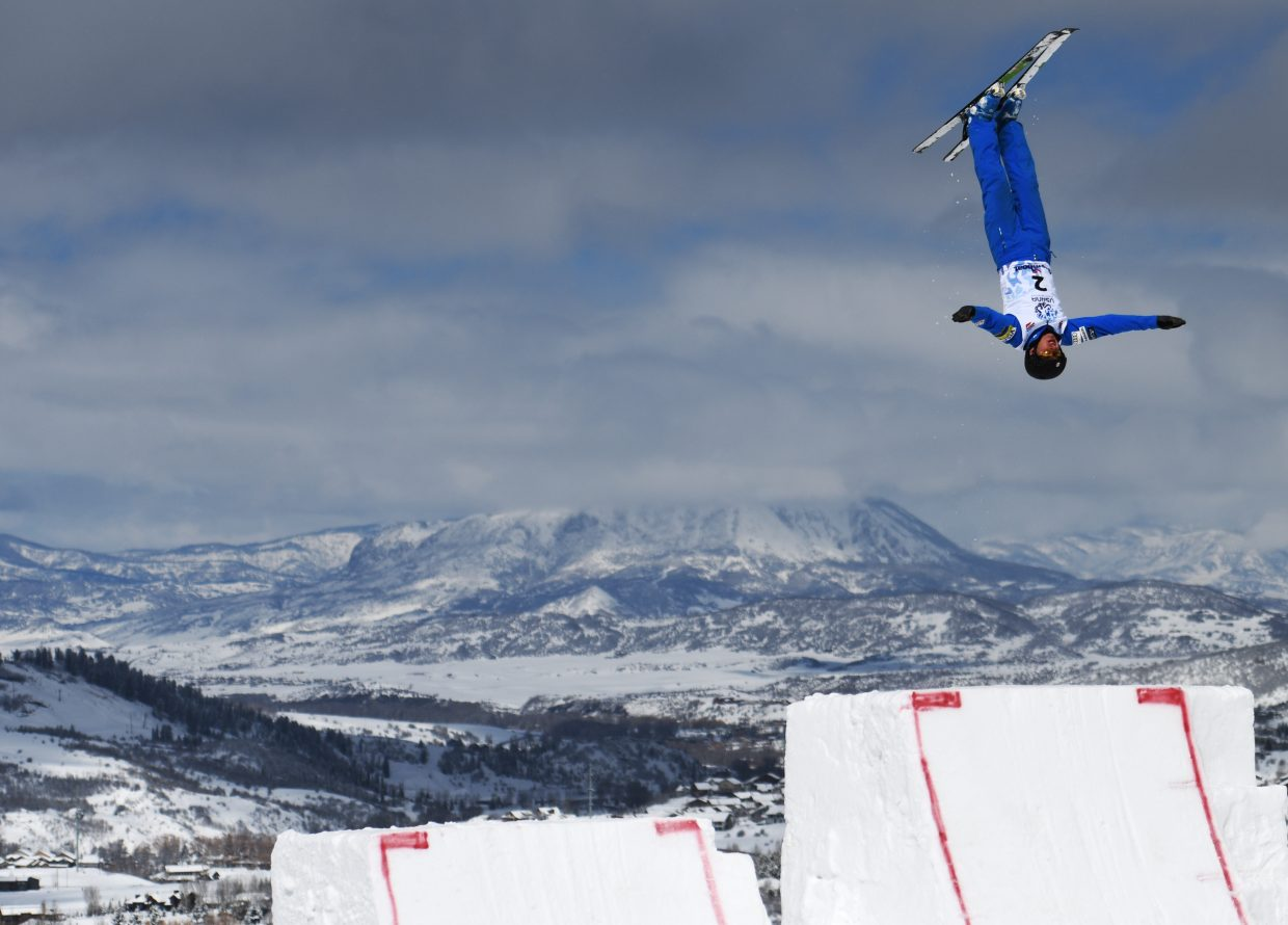 Christopher Lillis flies high above the aerials jumps during practice at the U.S. Freestyle Championships in Steamboat Springs.