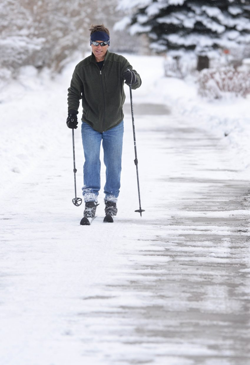 Steamboat Springs resident Jeff Clayton makes his way around patches of concrete while cross-country skiing on the Yampa River Core Trail Friday morning. Clayton was hoping to get a ski in before the trails were cleared by plows.