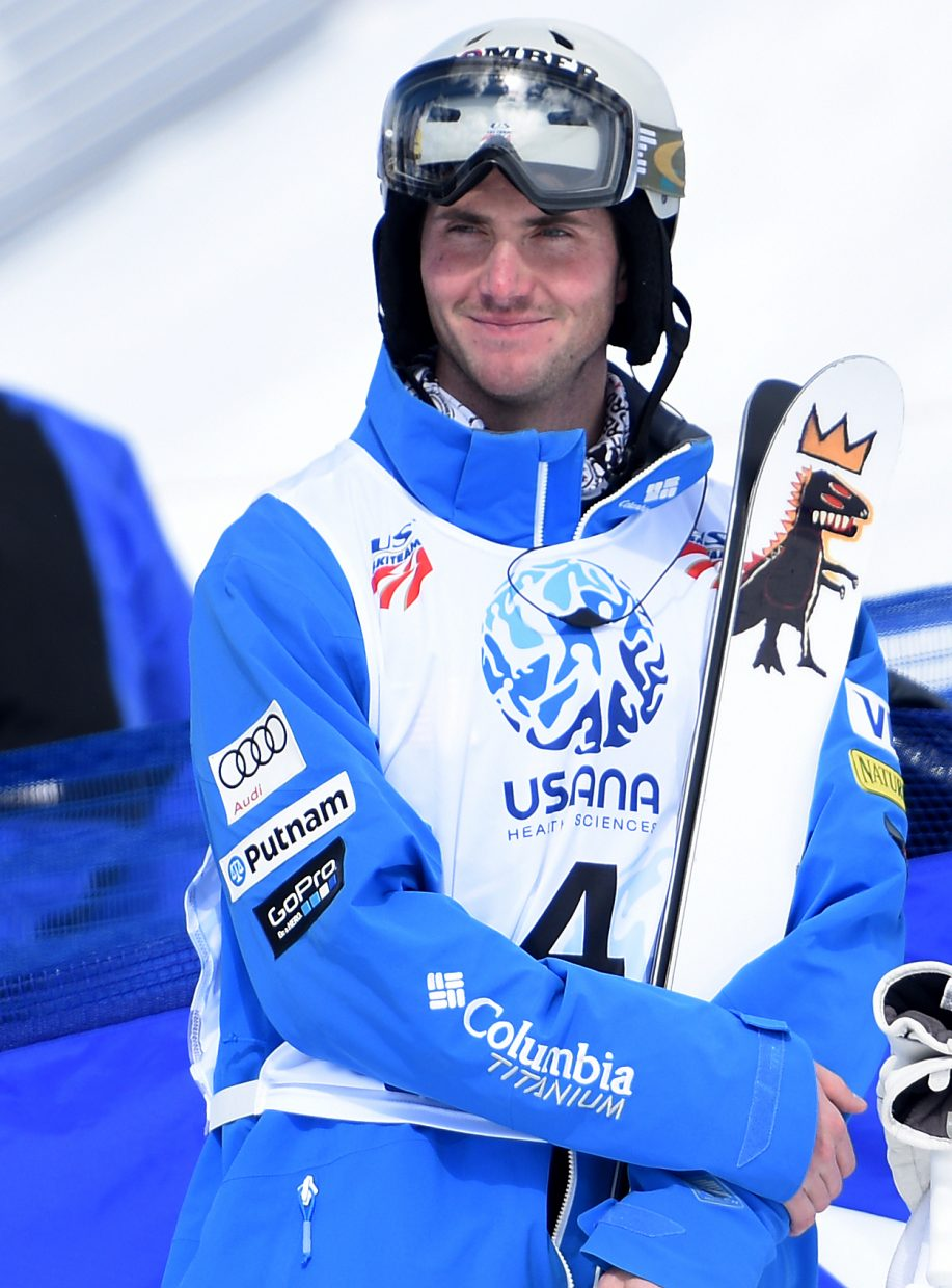 Steamboat Springs skier Jeremy Cota smiles as he waits for scores to come in during the men's moguls national championships at Steamboat Ski Area.