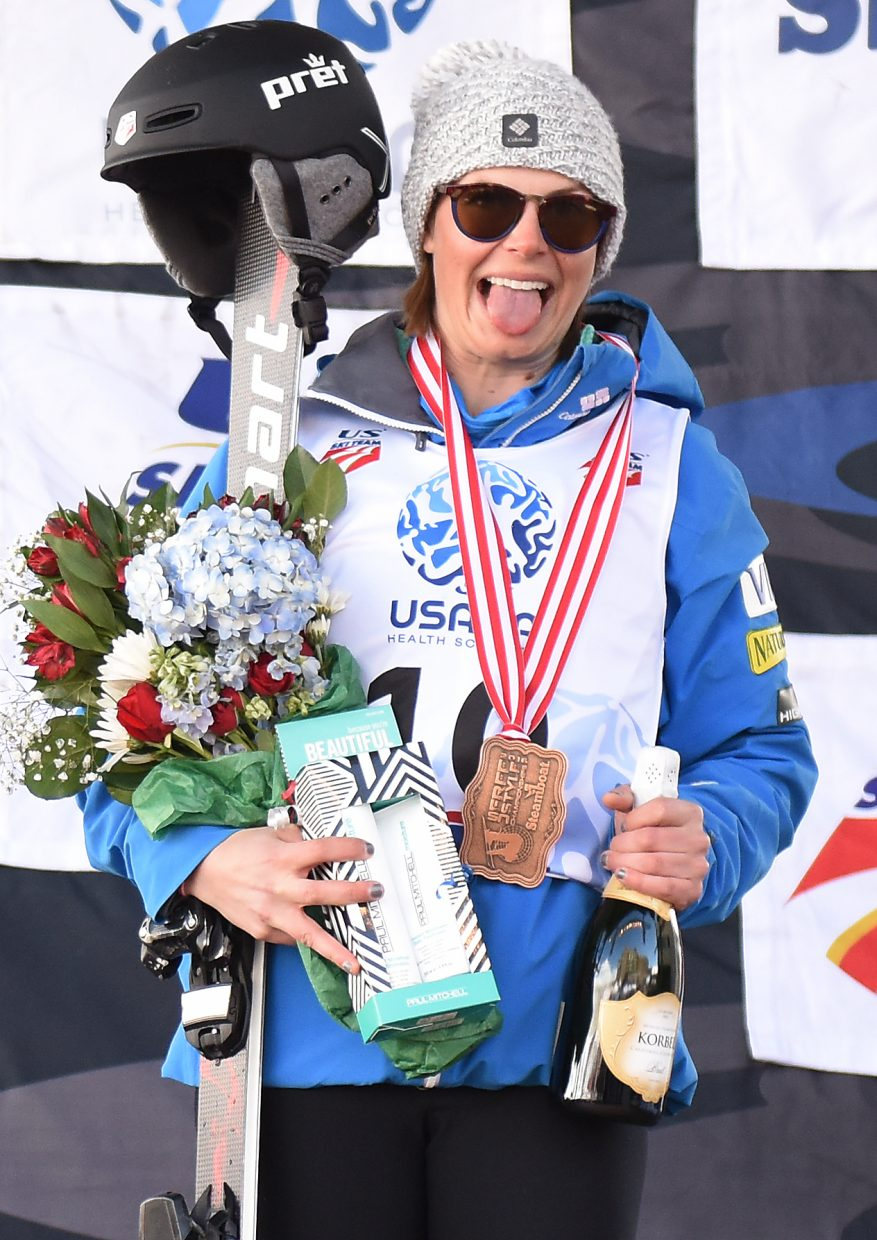 Steamboat skier Lane Stoltzner sticks out her tongue will on the podium, having finished second in the women's moguls national championship in Steamboat Springs.