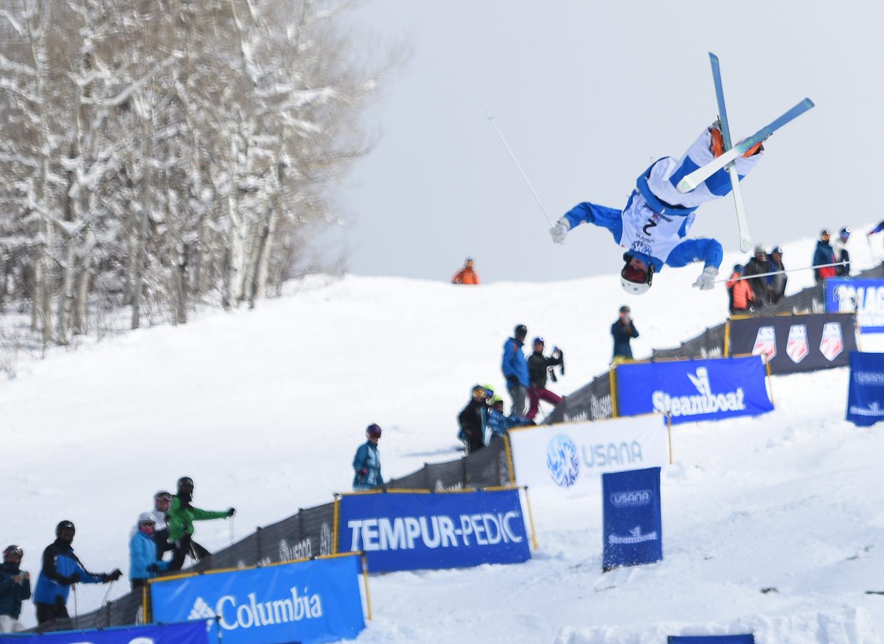 Thomas Rowley flies above the crowd Friday during the men's moguls national championships. The New York skier went big on his jumps and kept it together through the bumps, paving the way for a second national championship.