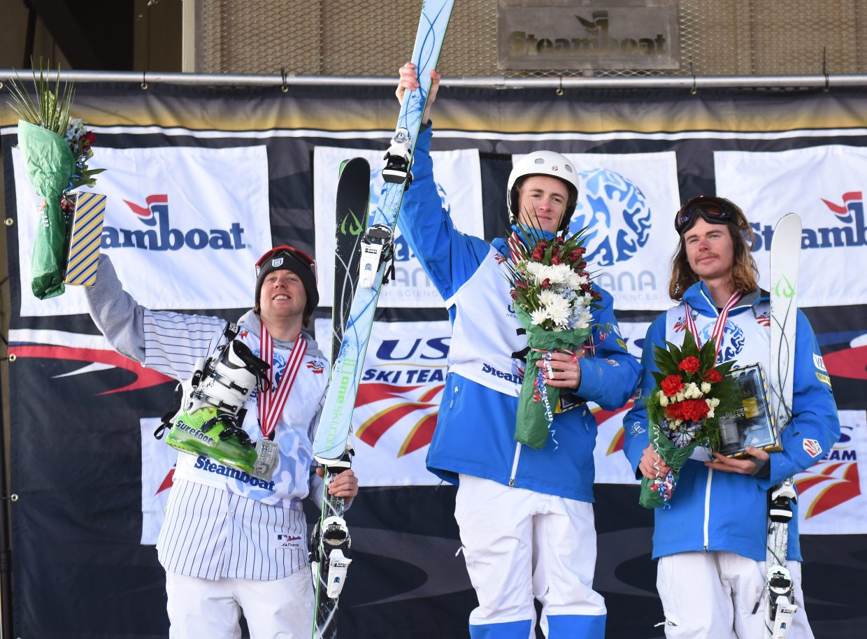 Thomas Rowley celebrates after winning the men's moguls championship at the U.S. Freestyle National Championships in Steamboat Springs. Bryan Zemba was second and Dylan Walczyk was third.