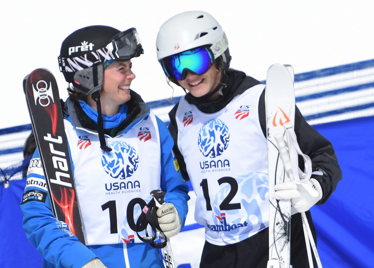 Steamboat Springs skiers Olivia Giaccio, right, and Lane Stoltzner share a smile after they locked up podium finishes in the women's moguls national championship event on Friday in Steamboat Springs.