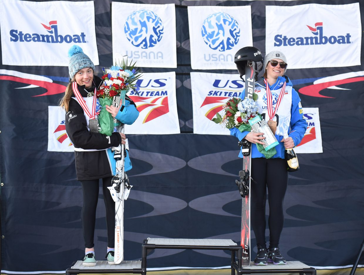 Steamboat Springs' skiers Olivia Giaccio, left, and Lane Stoltzner stand on the podium and their second- and third-place finishes at the U.S. Freestyle National Championships in Steamboat Springs.