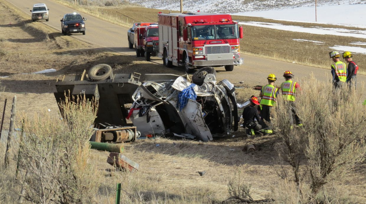 Emergency personnel respond to a vehicle rollover Friday afternoon on Moffat County Road 7.
