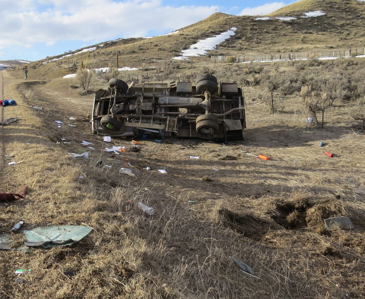 An overturned vehicle sits on the side of Moffat County Road 7.