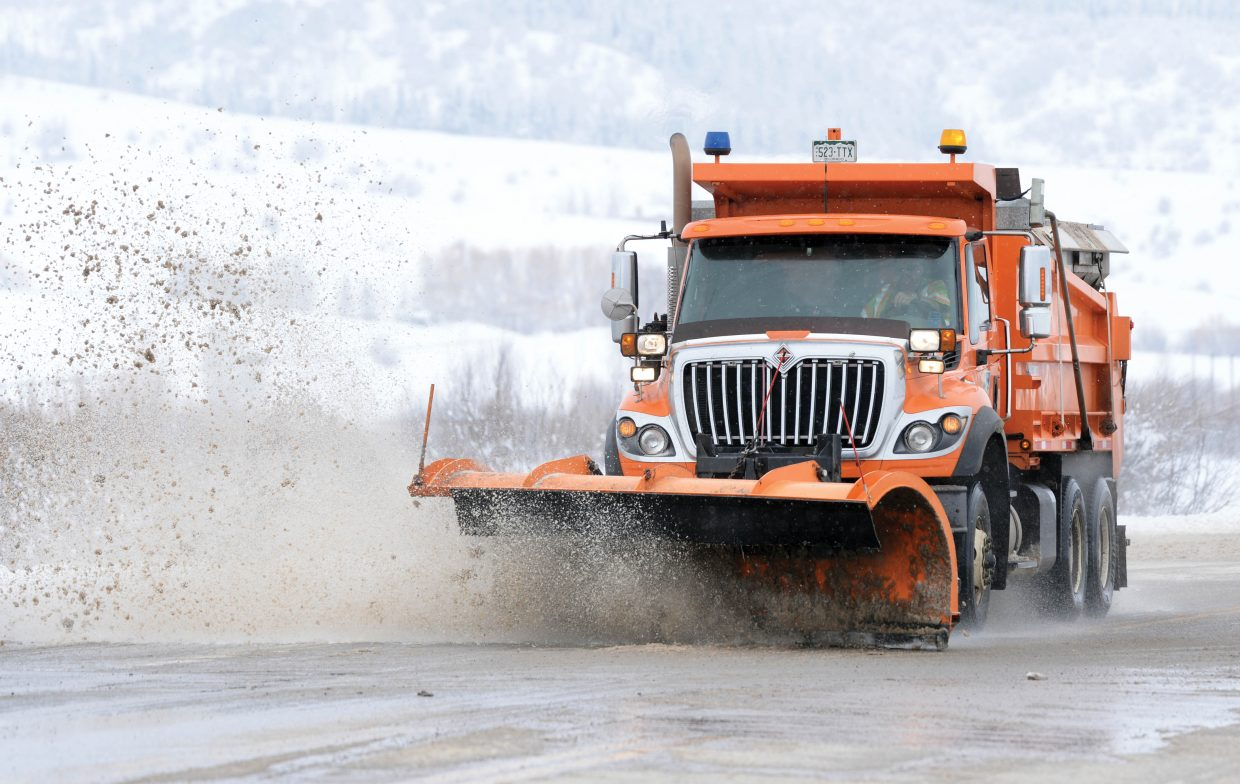 A Colorado Department of Transportation plow truck clears slush from U.S. Highway 40 east of Steamboat Springs Friday morning. Several recent storms have kept road crews on their toes the past several days.