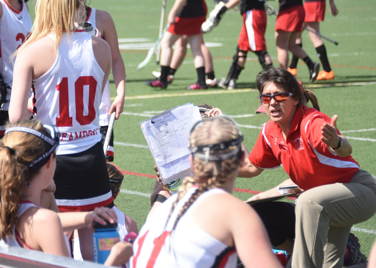 Steamboat girls lacrosse coach Betsy Frick coaches her team during halftime of Saturday's game against Durango.