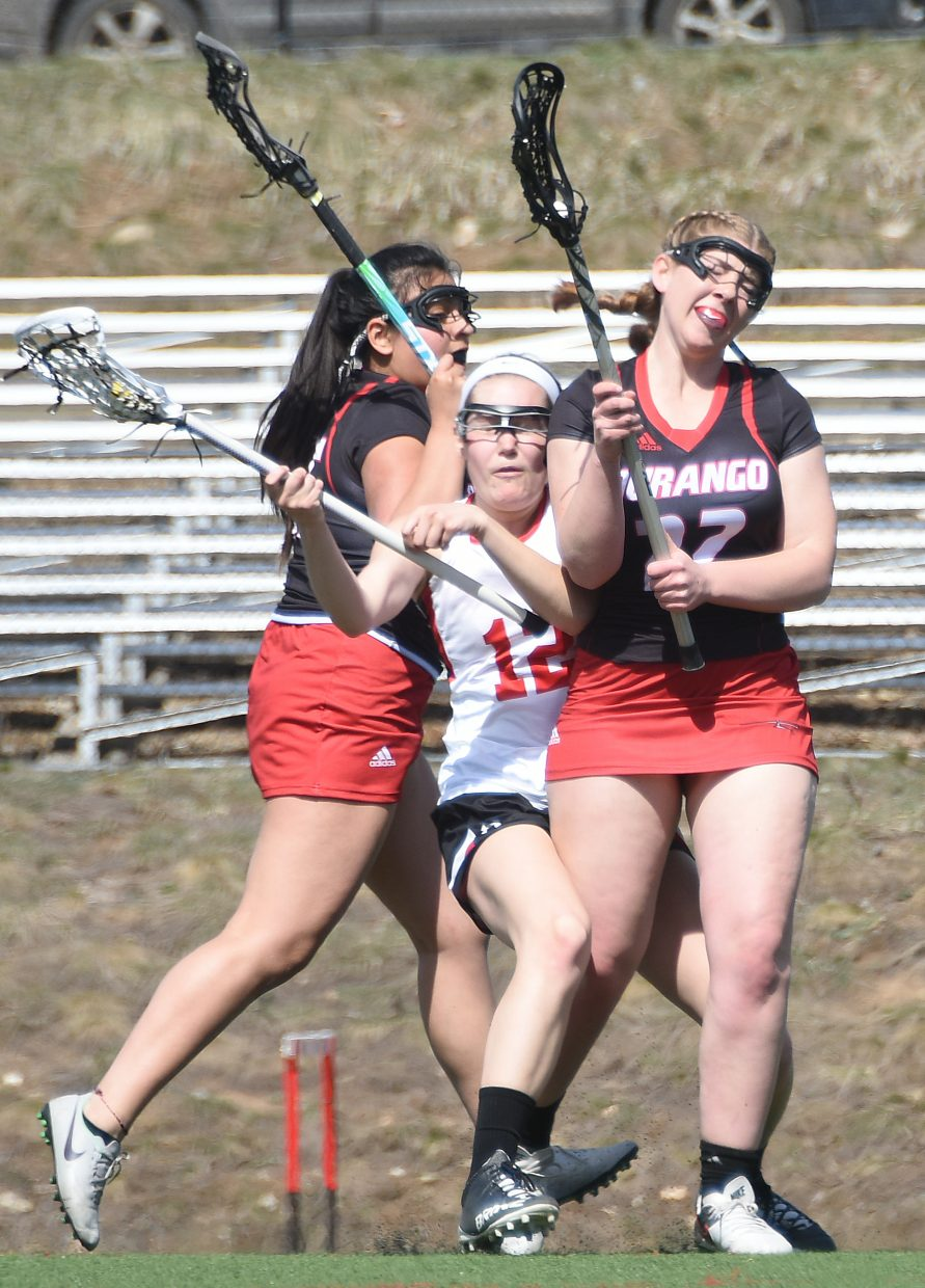 Steamboat's Maura Glynn feels the crunch of the Durango defense Saturday.