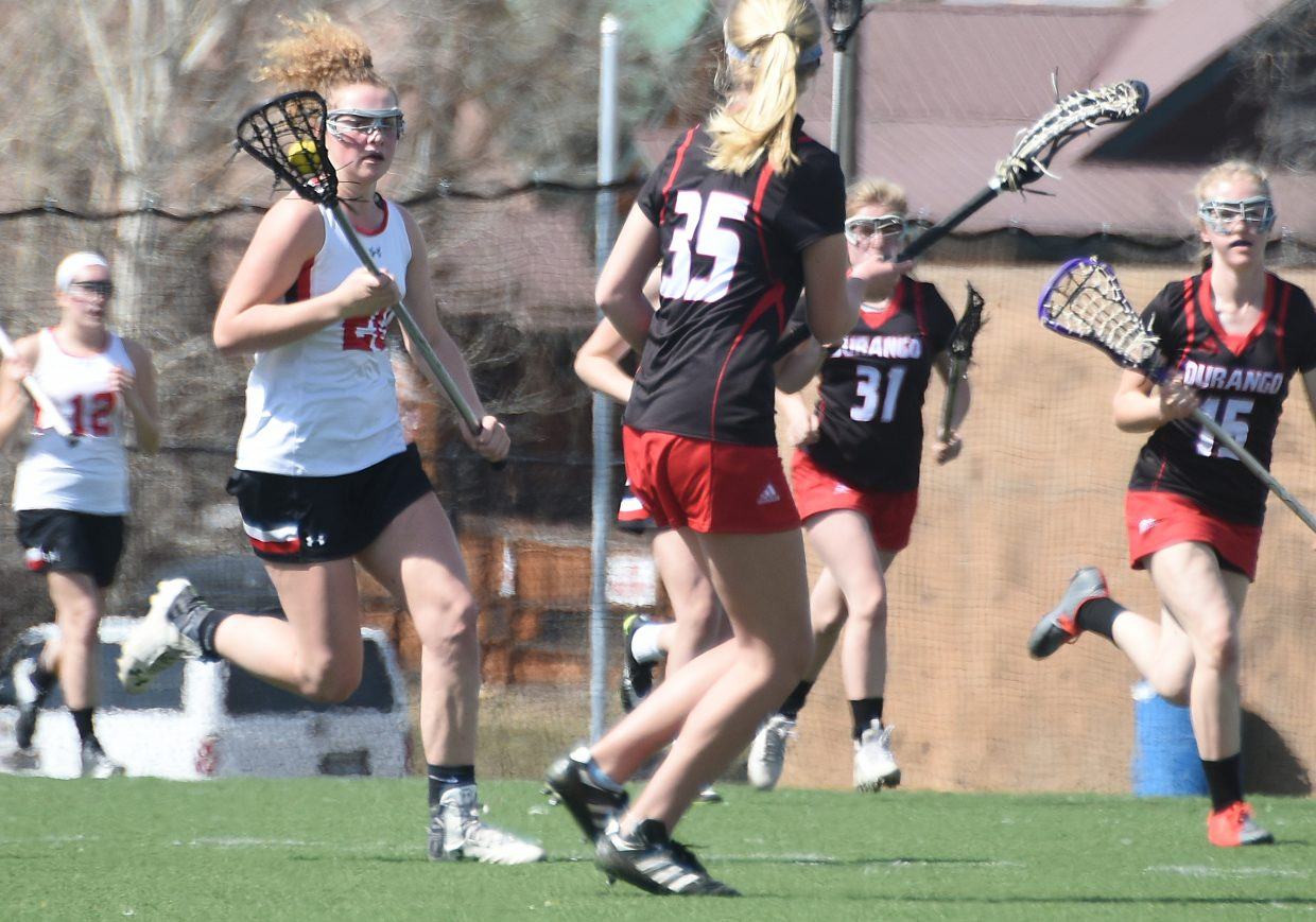 Steamboat freshman Riley Schott charges up the field Saturday against Durango. Schott scored four goals in the game to help the Sailors to a 9-6 win and a 5-0 record.
