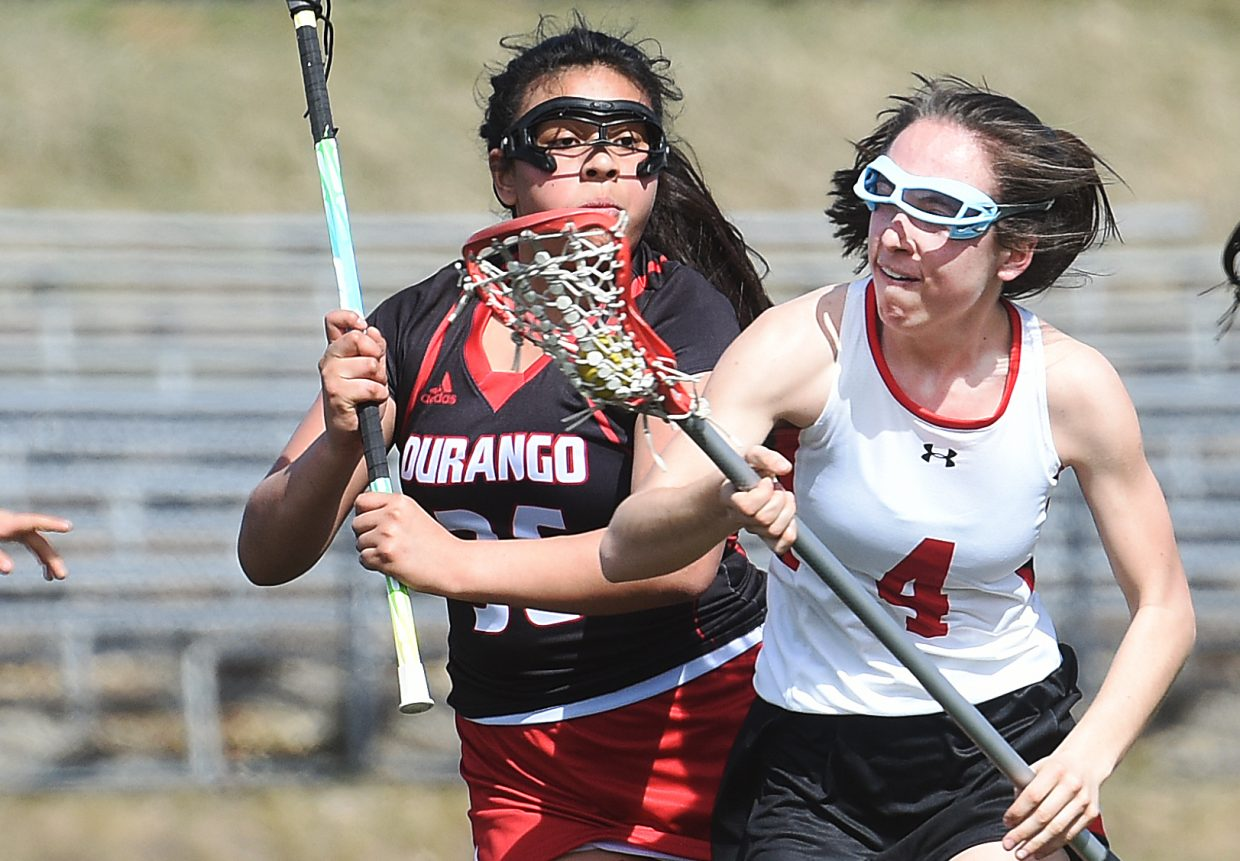 Steamboat junior Thyme Zuschlag tries to hold off the Durango defense Saturday.