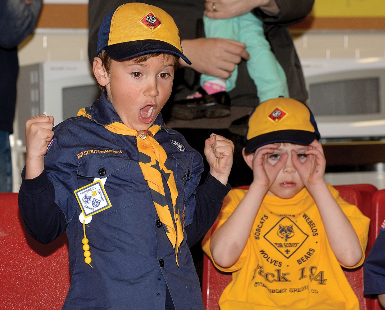 Cub Scout Kyan Strong cheers and his pal Ben Hearn keeps an eye on the finishes in a tight Pinewood Derby race Wednesday evening at the Steamboat Springs Middle School. Steamboat Cub Scout Troop 194 gathers every year to host the Pinewood Derby races for local scouts.