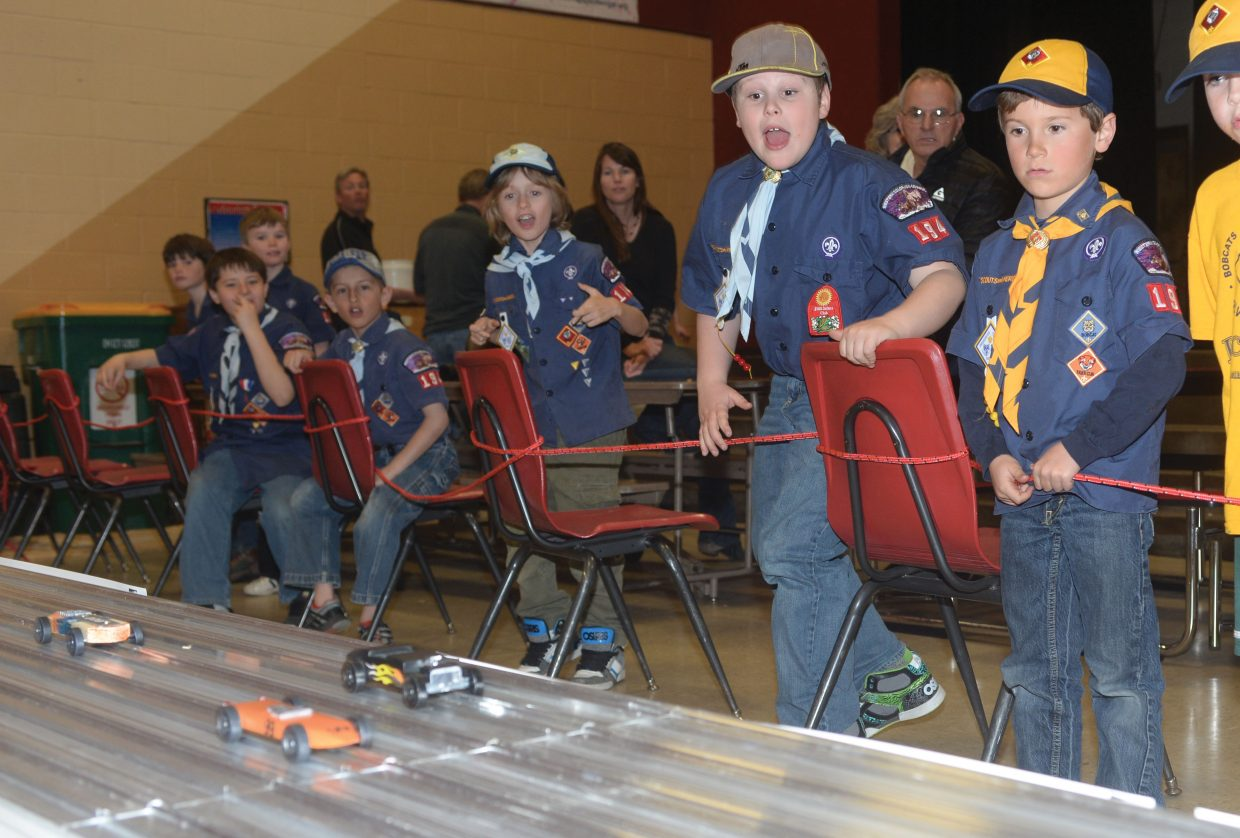Cub Scout Jacob Zuccone, middle, cheers as Pinewood Derby cars race down the track Wednesday evening at Steamboat Springs Middle School. Steamboat Cub Scout Troop 194 gathers every year to host the races for the local scouts.