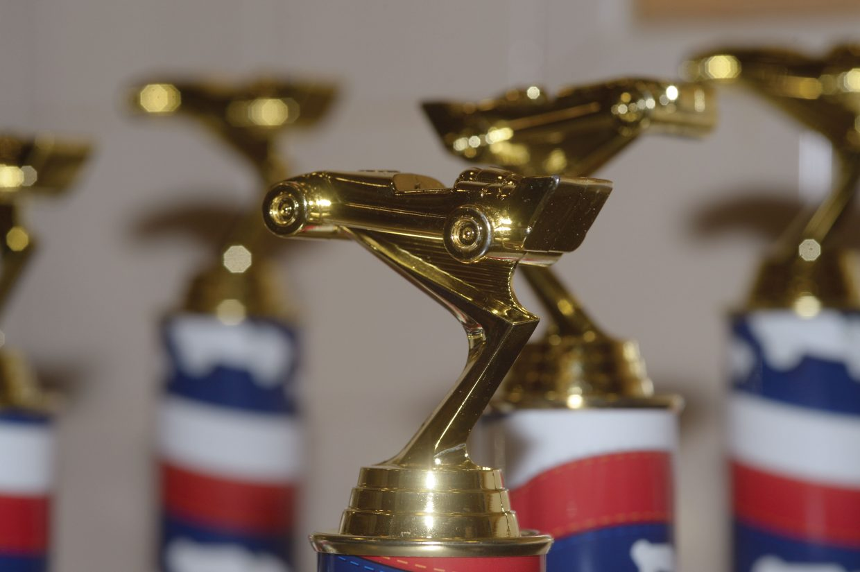 Trophies await the winners of the 2014 Pinewood Derby races Wednesday evening. The races were hosted by Cub Scout Troop 194.