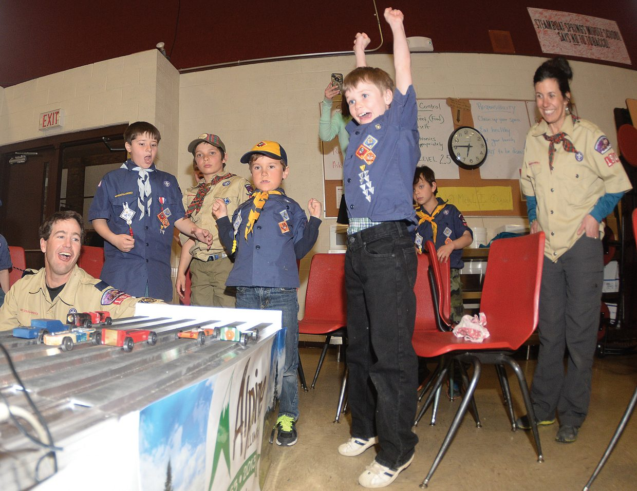 Cub Scout Jayden Patrick celebrates after his car won one of the heats in the finals of the Pinewood Derby on Wednesday evening at Steamboat Springs Middle School. The races are hosted by Cub Scout Troop 194 every year.