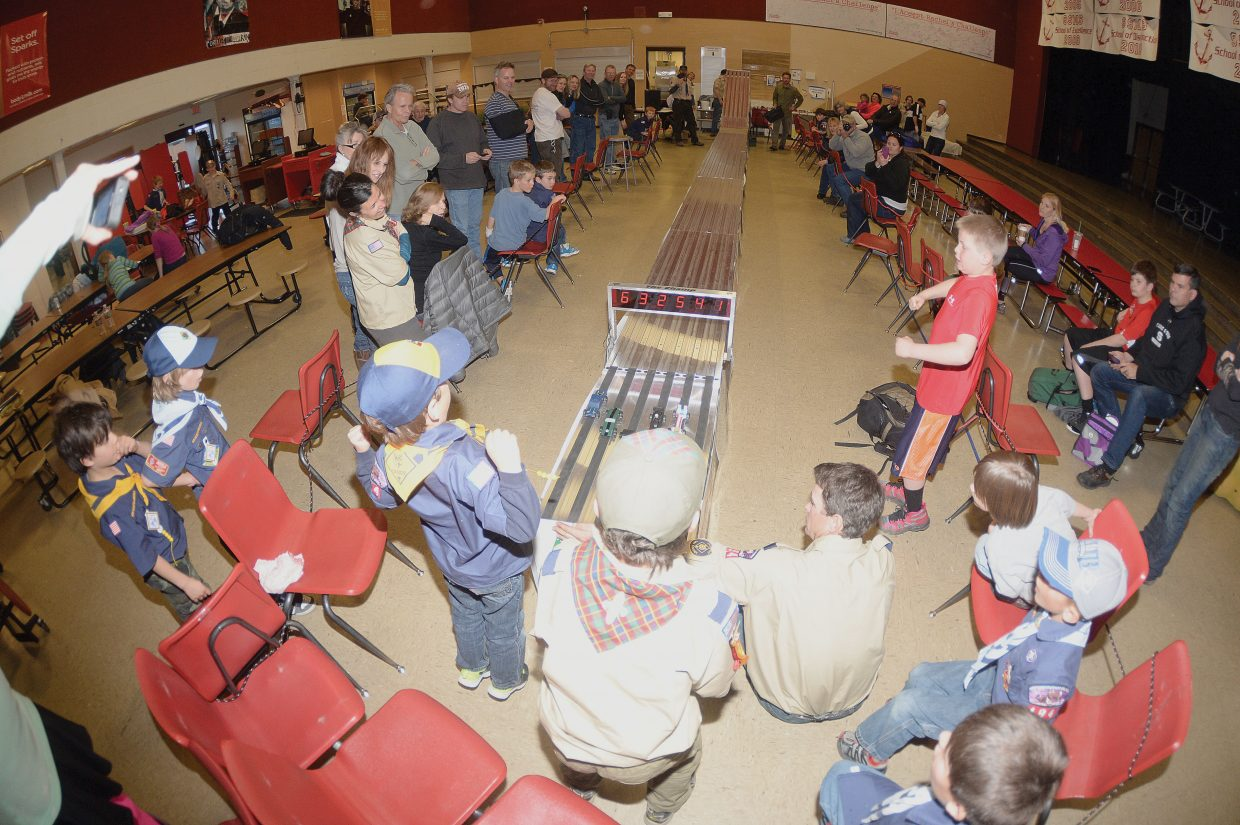 Pinewood Derby cars cross the finish line Wednesday evening at Steamboat Springs Middle School. Steamboat Cub Scout Troop 194 gathers every year to host the races for local scouts.