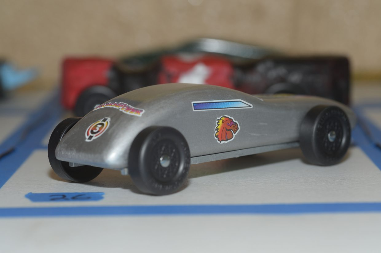 A car waits for it chance to race down the track at the annual Cub Scouts Pinewood Derby on Wednesday evening at Steamboat Springs Middle School.