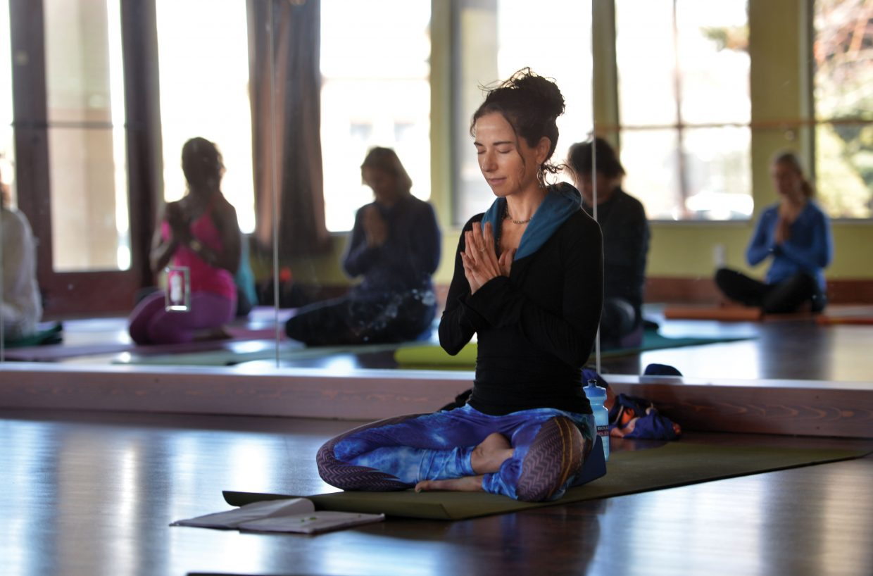 Yoga instructor Valerie Dambroskio teaches a class at Sundance Studio on Thursday afternoon. This weekend yoga enthusiasts will be drawn to the Spring Awakening, a yoga retreat in Steamboat Springs.