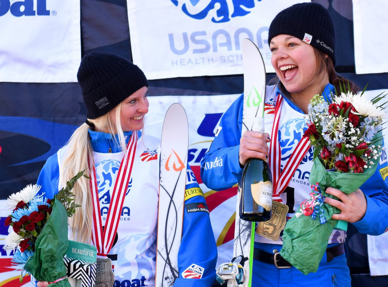 Aerials skiers Kiley McKinnon, left, and Ashley Caldwell celebrate their podium finishes, second and first respectively, Saturday at the U.S. Freestyle National Championships in Steamboat Springs.