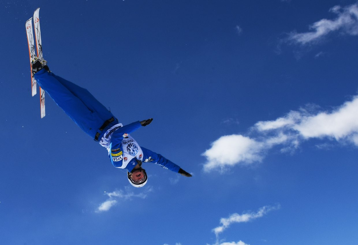 Kiley McKinnon spins in the clouds Saturday during the U.S. Freestyle National Championships aerials event in Steamboat Springs. She finished second.