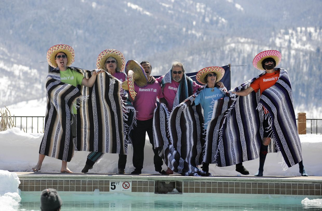 Employees from The Foundry perform before jumping in the Penguin Plunge pool.