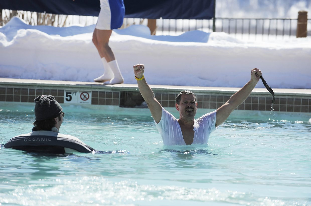 Young Professionals Network member Geoff Petis walks through the pool during the Penguin Plunge.