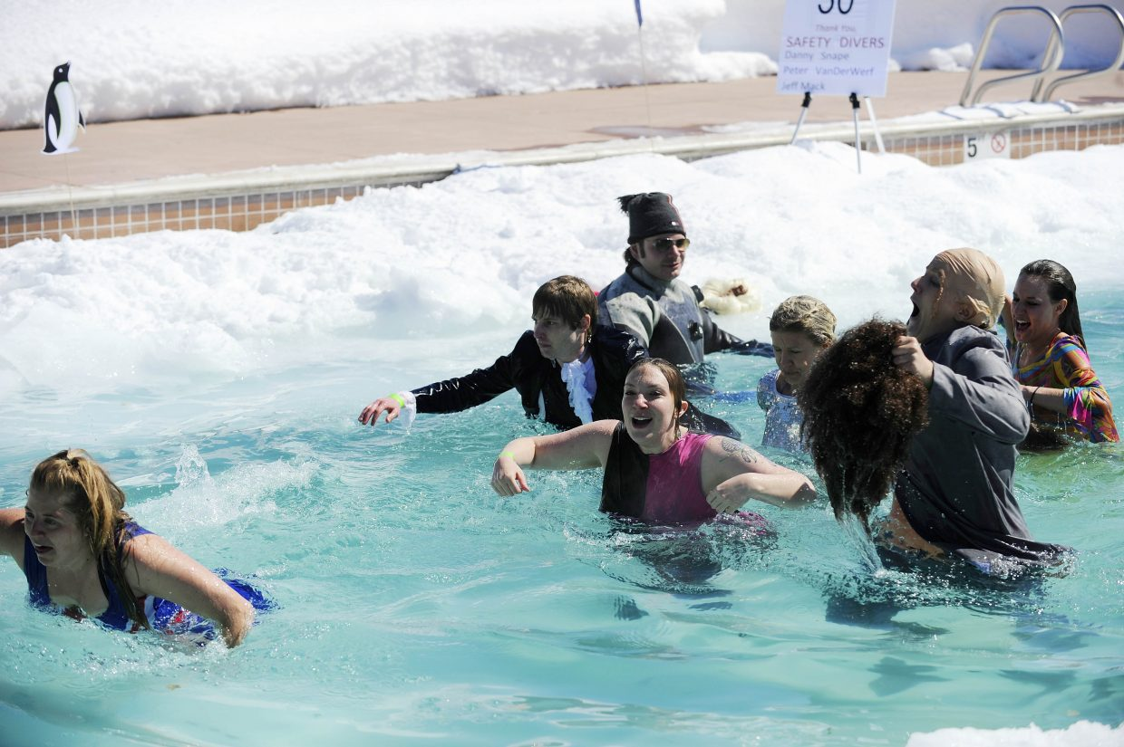 Yampa Valley Bank employees run through the pool during the Penguin Plunge.