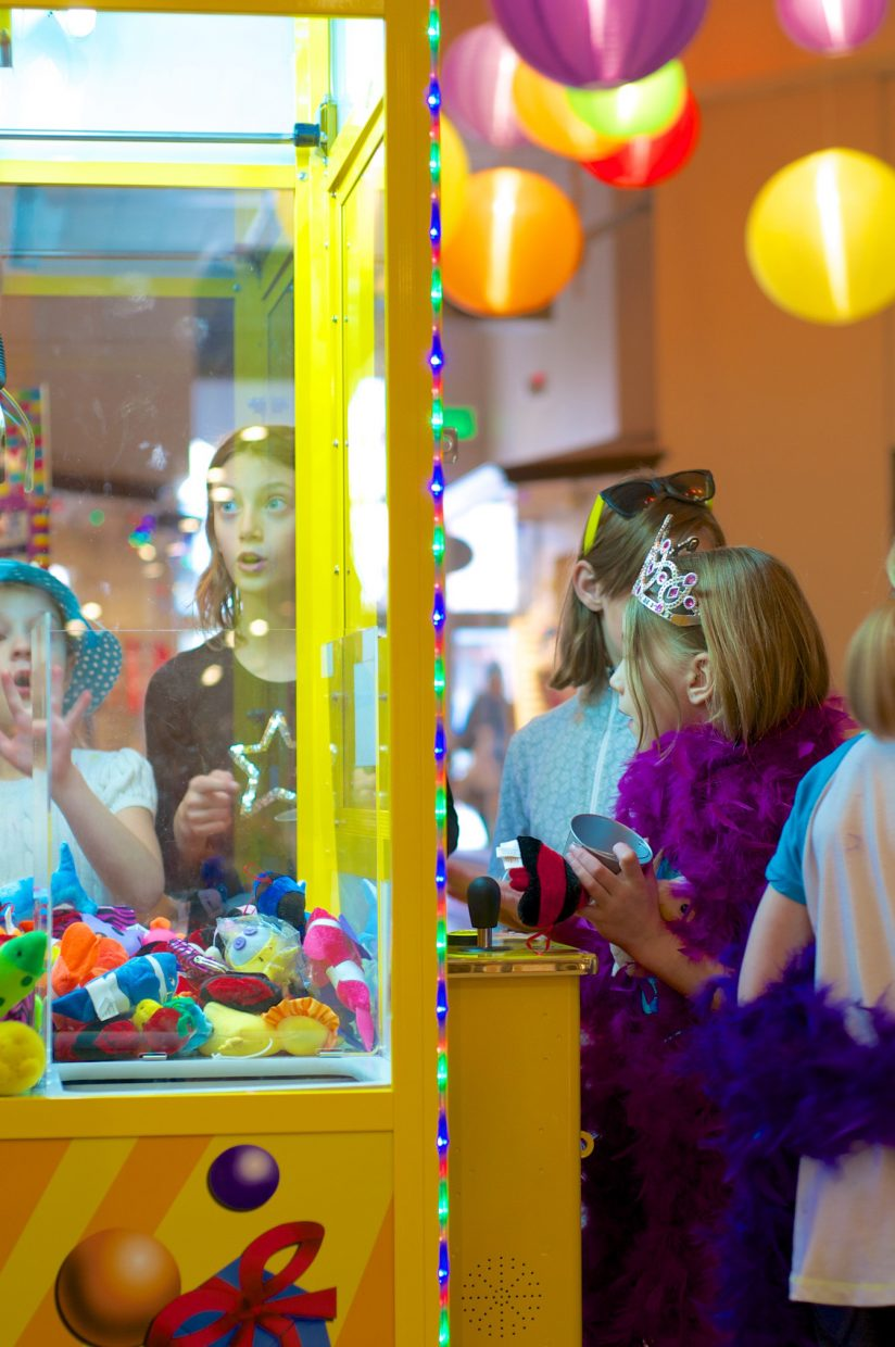 Children celebrate a birthday party and play the crane game at in Celebration of Kids.