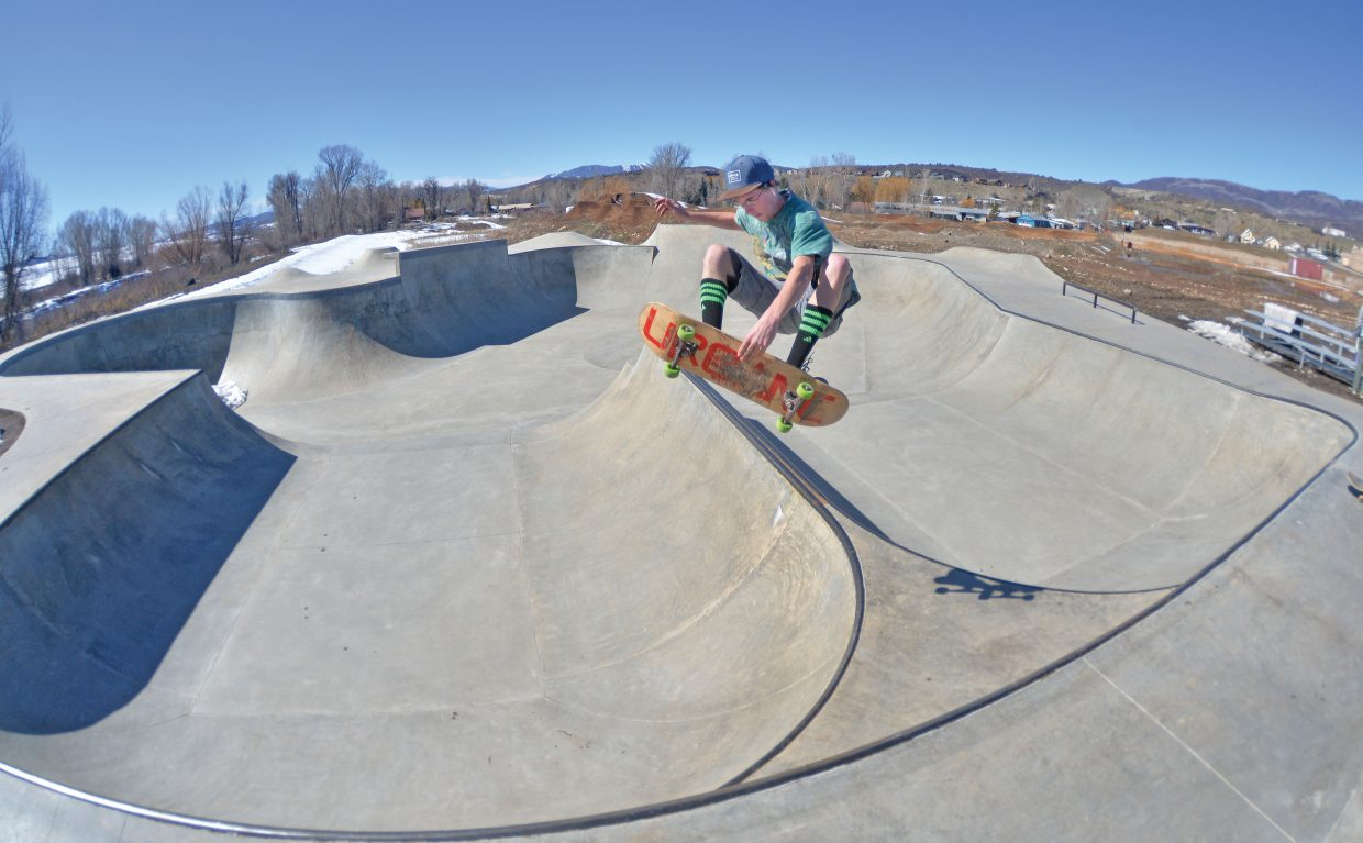 Skateboarder Tommy Hamm enjoys the first day of spring at the Bear River Park in Steamboat Springs. Thanks to the efforts of snowboarders who shoveled snow off the concrete, the park is open for business.