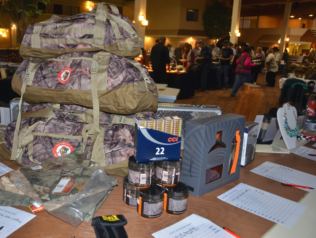 A variety of hunting gear and other items are up for bids as diners fill up their plates at the eighth annual Safari Club International Yampa Valley Chapter fundrasier banquet at the Clarion Inn & Suites. The night included dinner, games and silent and live auctions.