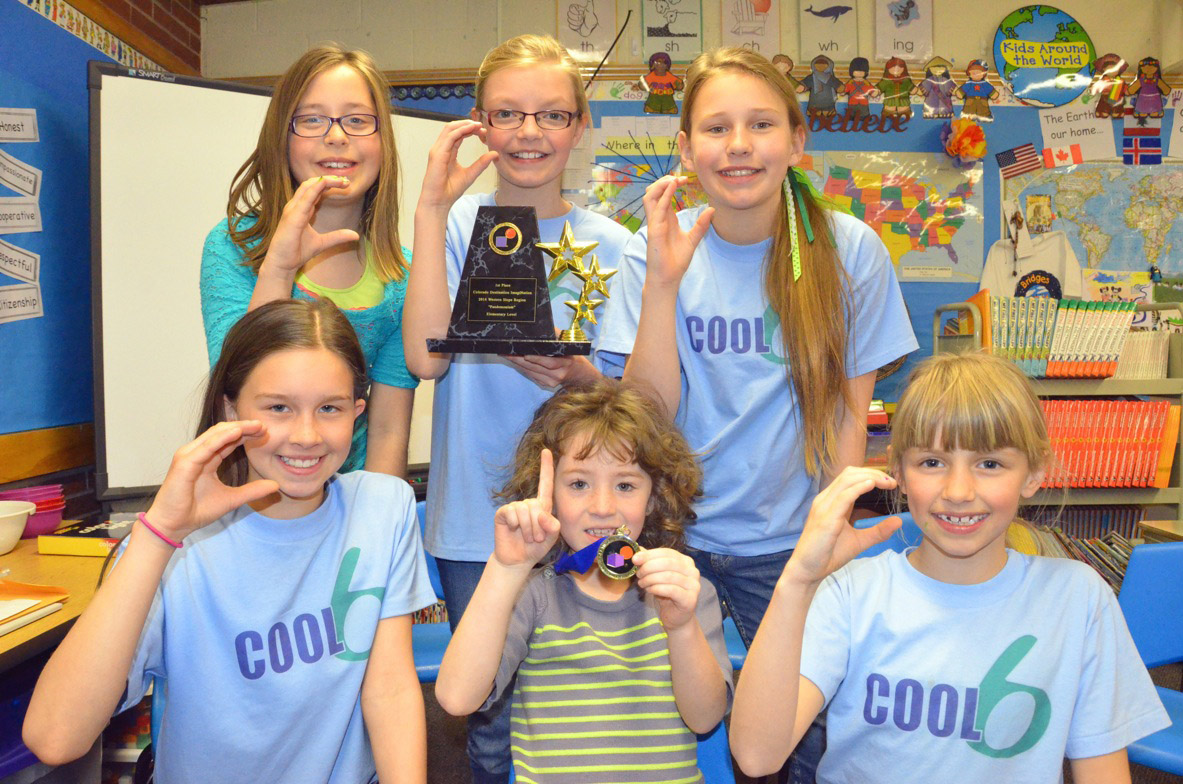 Clockwise from bottom left, Sunset Elementary School students Emaleigh Papierski, Allison Jacobson, Abbe Adams, Alexa Neton and Emma Jones flash the Cool 6 team symbol, while Hannah Kilpatrick, center, holds high her medal and the symbol for No. 1 following their first place victory at the Destination Imagination Western Slope Regional Tournament. Eight teams from Moffat County participated in the event March 15, with three qualifying for a state-level competition April 12 in Denver.