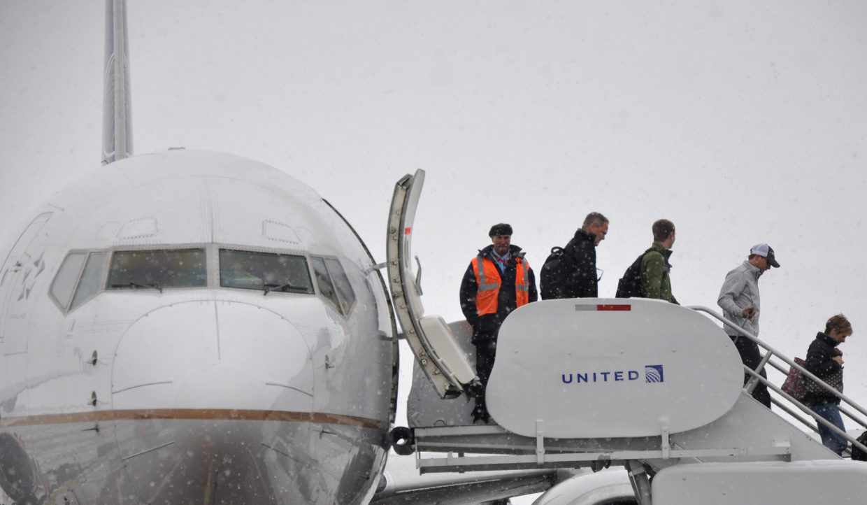 Passengers unload from a United Airlines plane at Yampa Valley Regional Airport during the 2017 holiday season. The winter flight season begins Saturday, with about 500 passengers expected to fly into the airport.