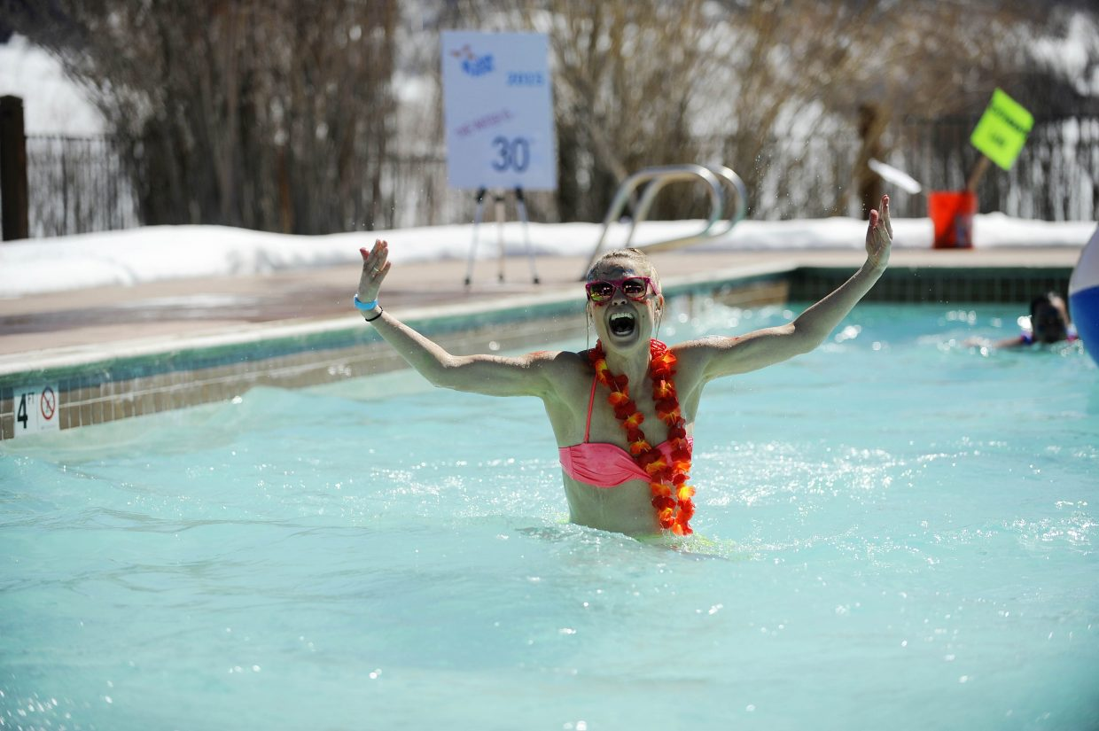 Rebecca Williams walks through the chilly waters of the Lake Catamount Ranch and Club pool Saturday during the 12th annual Penguin Plunge. The beneficiary of this year's Penguin Plunge is Yampa Valley Medical Center's new Cancer Care Center.