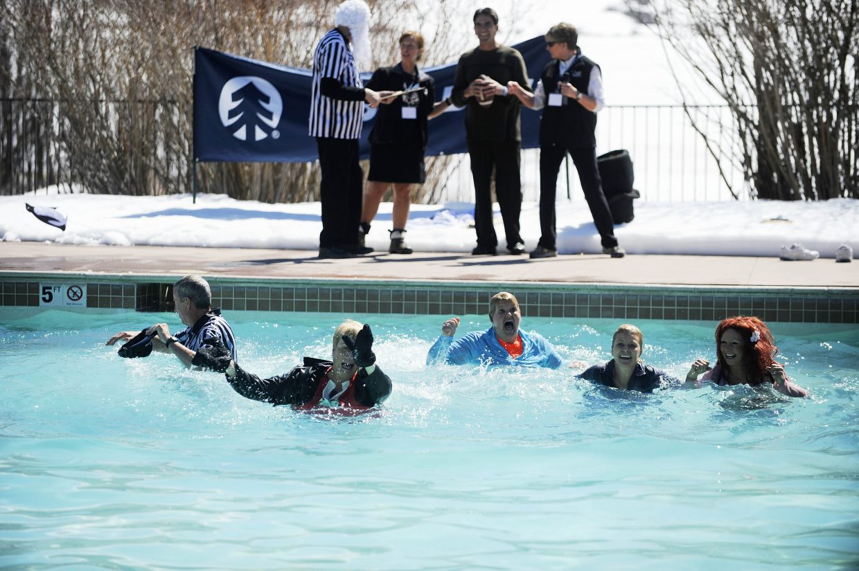 Celebrity judges jump in the pool during the Penguin Plunge Saturday at Lake Catamount Ranch and Club.