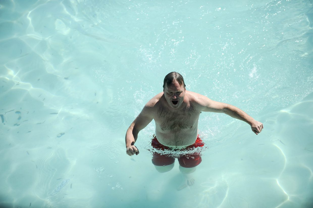 Brian Harvey with Steamboat Radio walks through the pool Saturday during the 12th annual Penguin Plunge.