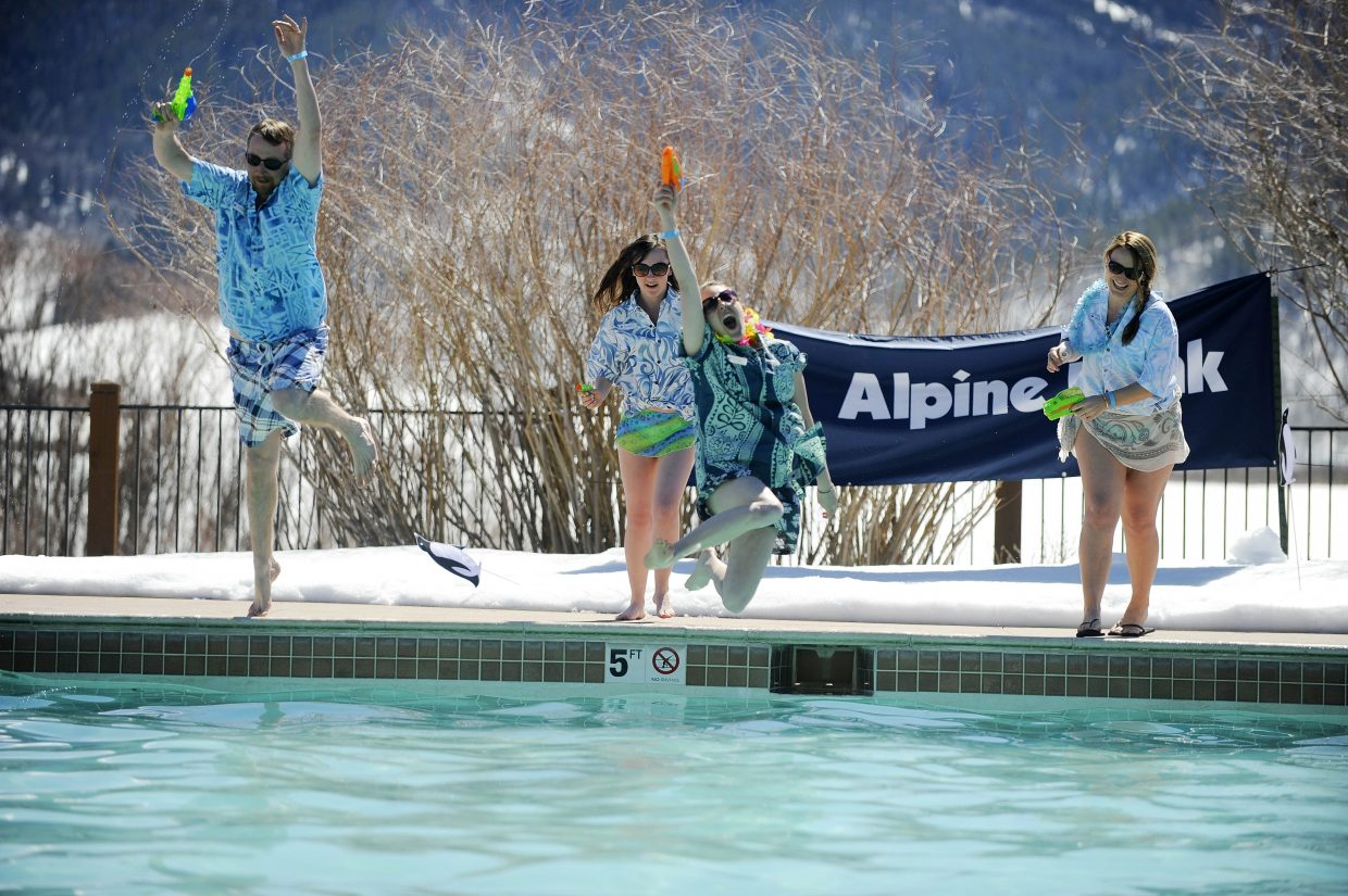 Lake Catamount Ranch and Club employees jump into the pool Saturday during the 12th annual Penguin Plunge.