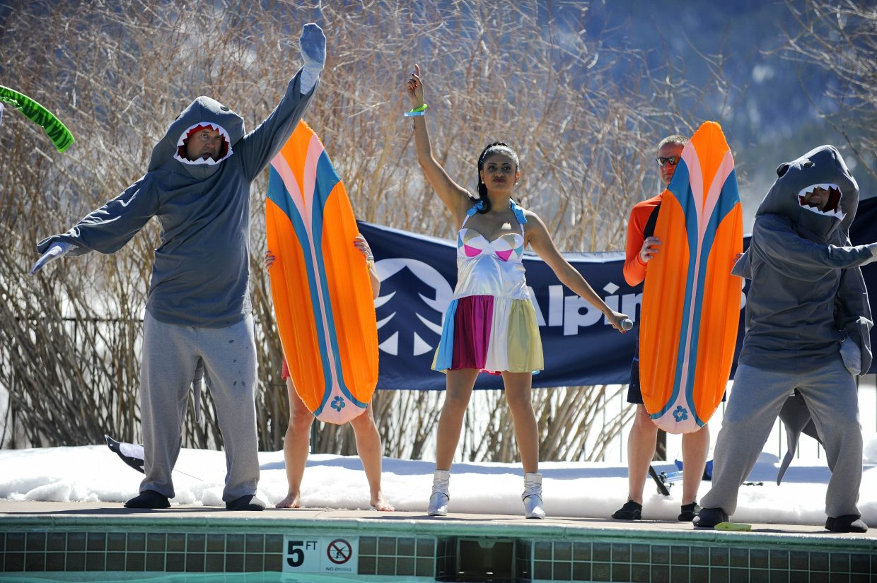 Yampa Valley Medical Center employees perform at the Lake Catamount Ranch and Club pool Saturday during the 12th annual Penguin Plunge at the Lake Catamount Ranch and Club.