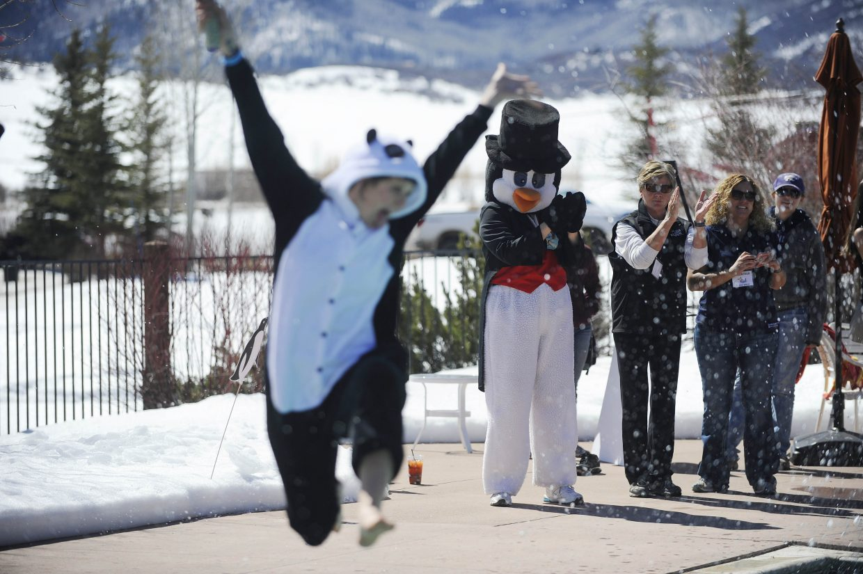The penguin cheers on participants Saturday during the 12th annual Penguin Plunge at the Lake Catamount Ranch and Club.