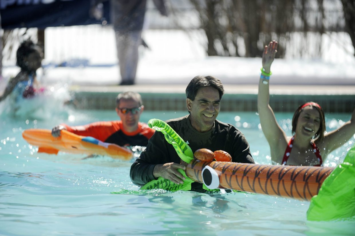 Yampa Valley Medical Center CEO Frank May walks through the pool at Lake Catamount Ranch and Club Saturday during the 12th annual Penguin Plunge.