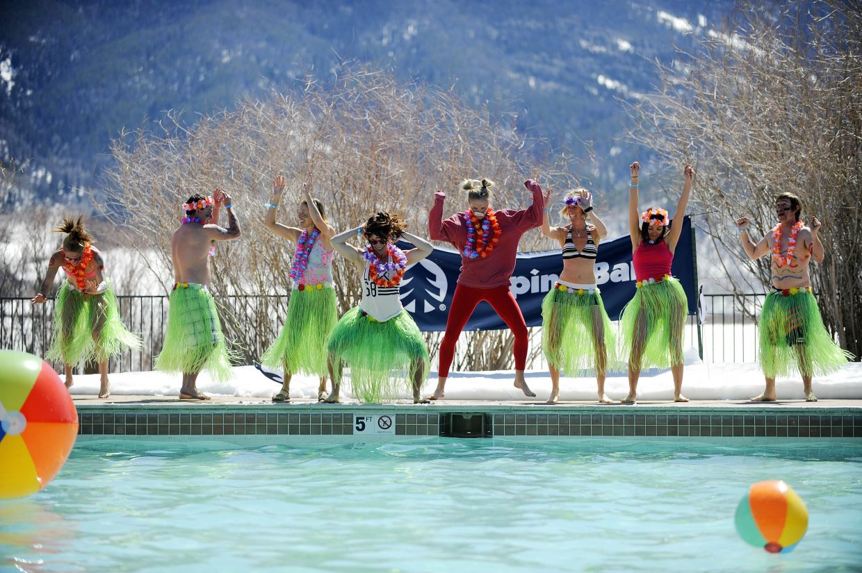 Old Town Hot Springs employees perform at the Lake Catamount Ranch and Club pool Saturday during the 12th annual Penguin Plunge at the Lake Catamount Ranch and Club.