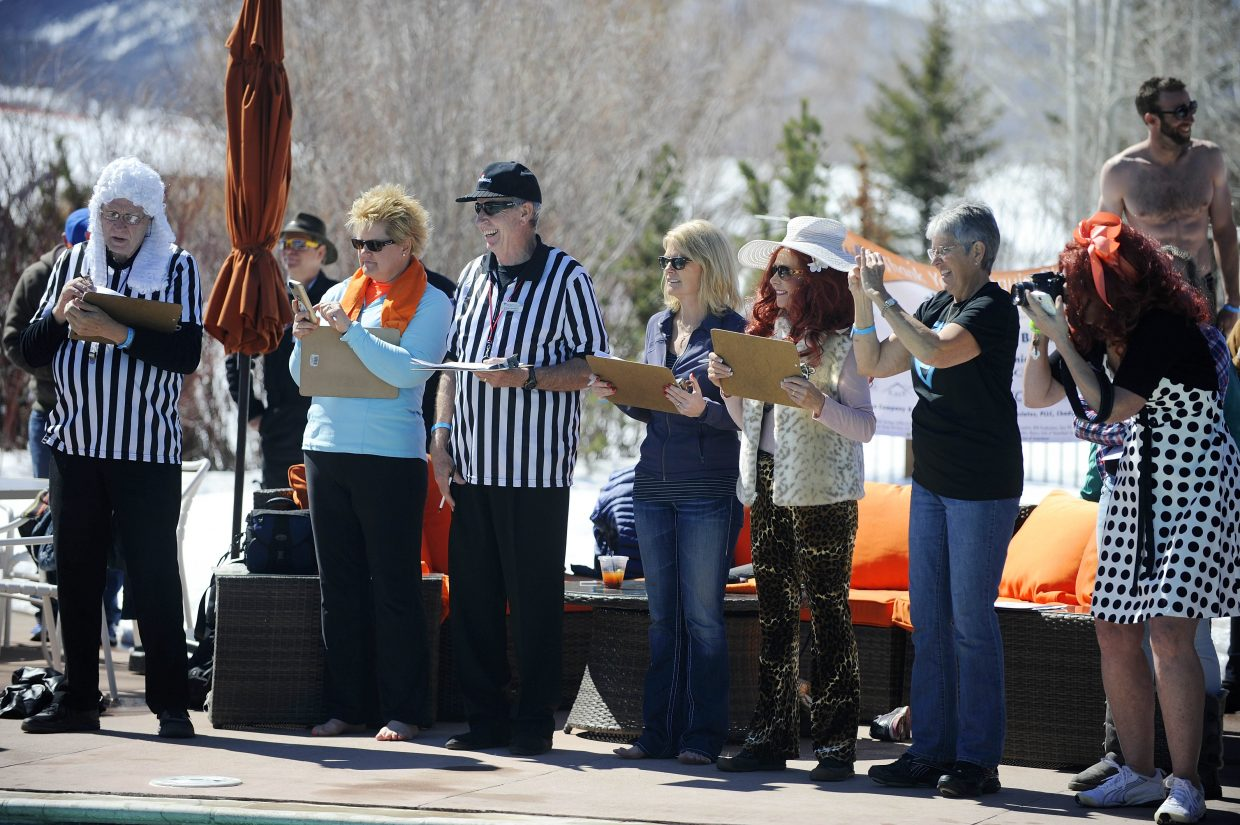 Celebrity judges score the participants at the Lake Catamount Ranch and Club pool Saturday during the 12th annual Penguin Plunge at the Lake Catamount Ranch and Club.