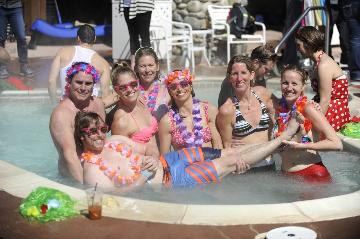 Members of the Old Town Hot Springs pose in the hot tub during the Penguin Plunge Saturday at Lake Catamount Ranch and Club.