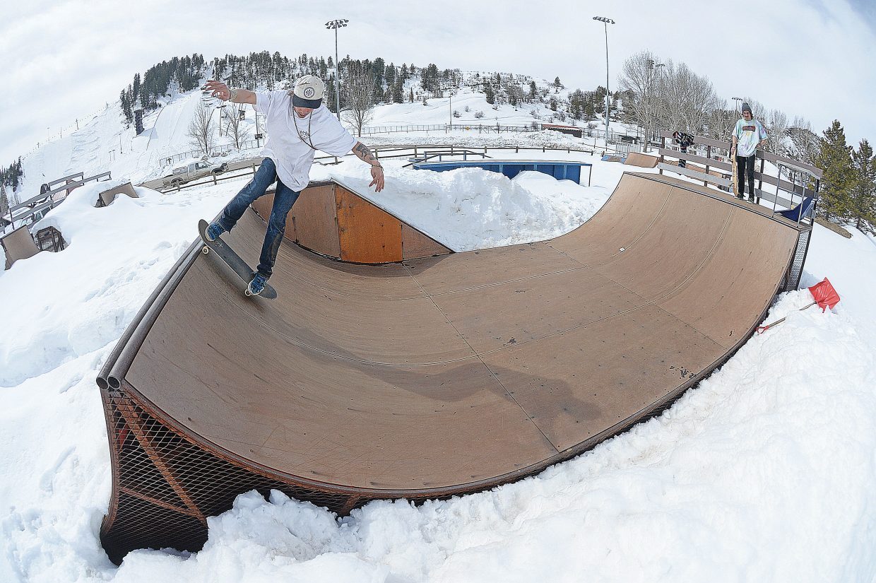 Alex Seng takes his turn in the ramp while skateboarding with buddy Hunter Burton at Howelsen Hill Park  Monday morning. The local skateboarders have been shoveling the snow off the ramp the past few weeks in order to get back on their boards for the start of a new season.
