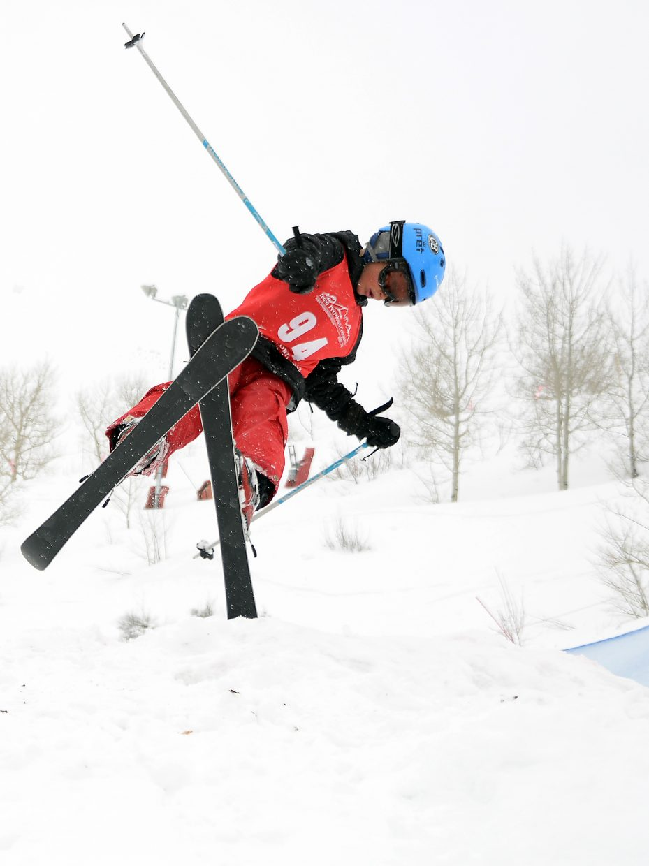Steamboat's David Schlicht skis spins off a jump Saturday during a moguls event at Steamboat Ski Area.