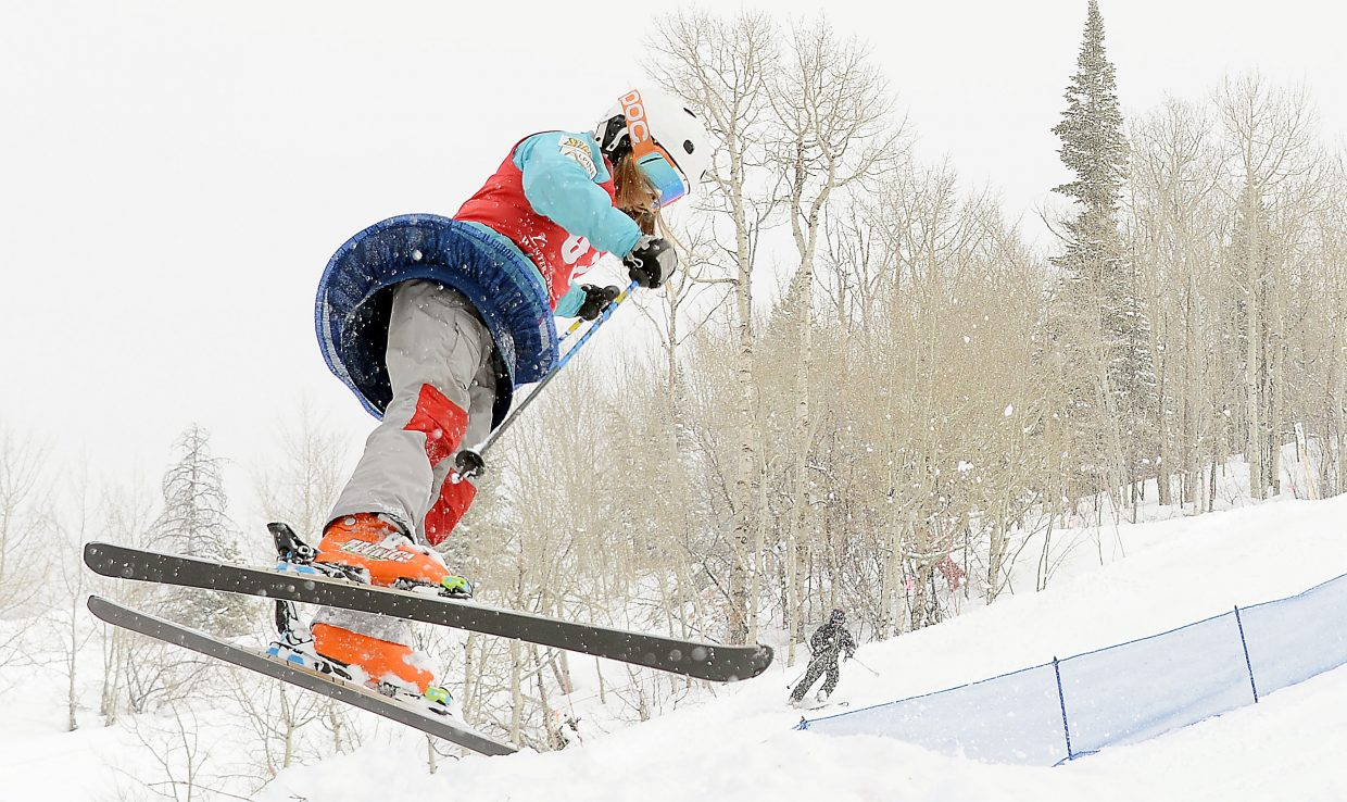 Steamboat's Kenzie Radway spins off a jump Saturday during a moguls event at Steamboat Ski Area. She ended up as the overall girls champion from the event.
