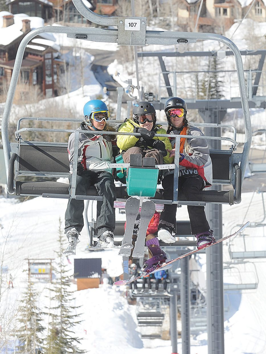 STARS guides Carly Koczera (left) and Cheyna Swartz (right) ride up the lift with Horizons client Alyessa Yeagher during a day at the Steamboat Ski Area. Horizons and STARS have teamed up to offer clients a chance to get out an enjoy the mountain.