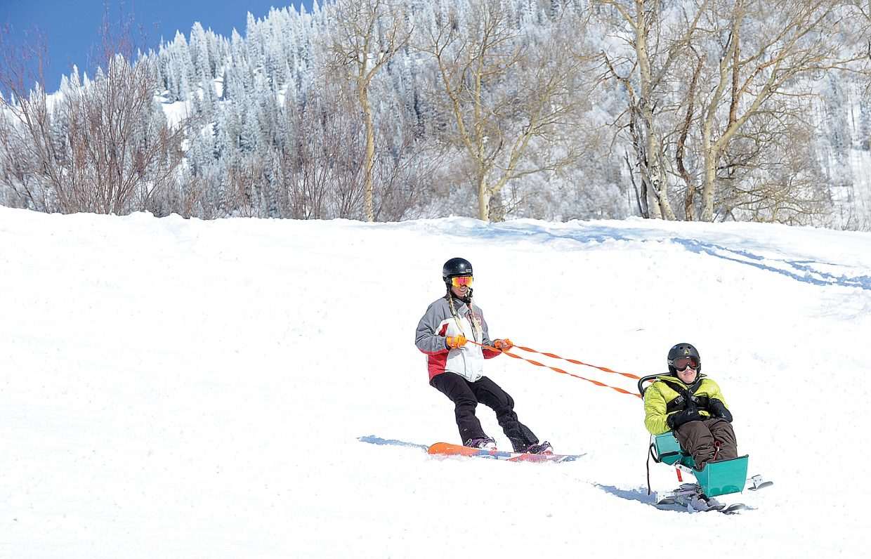 Alyessa Yeagher (right) makes some smooth turns on the slopes of the Steamboat Ski Area with a little help from STARS guide Cheyna Swartz. Yeagher is among the clients Horizons serves with support from the community through a 1-mill tax levy approved by voters in 2005.