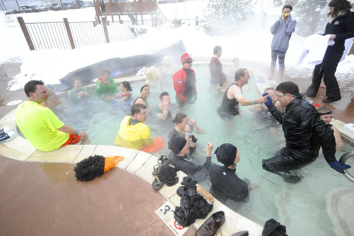 Participants warm up in the hot tub during the Penguin Plunge.