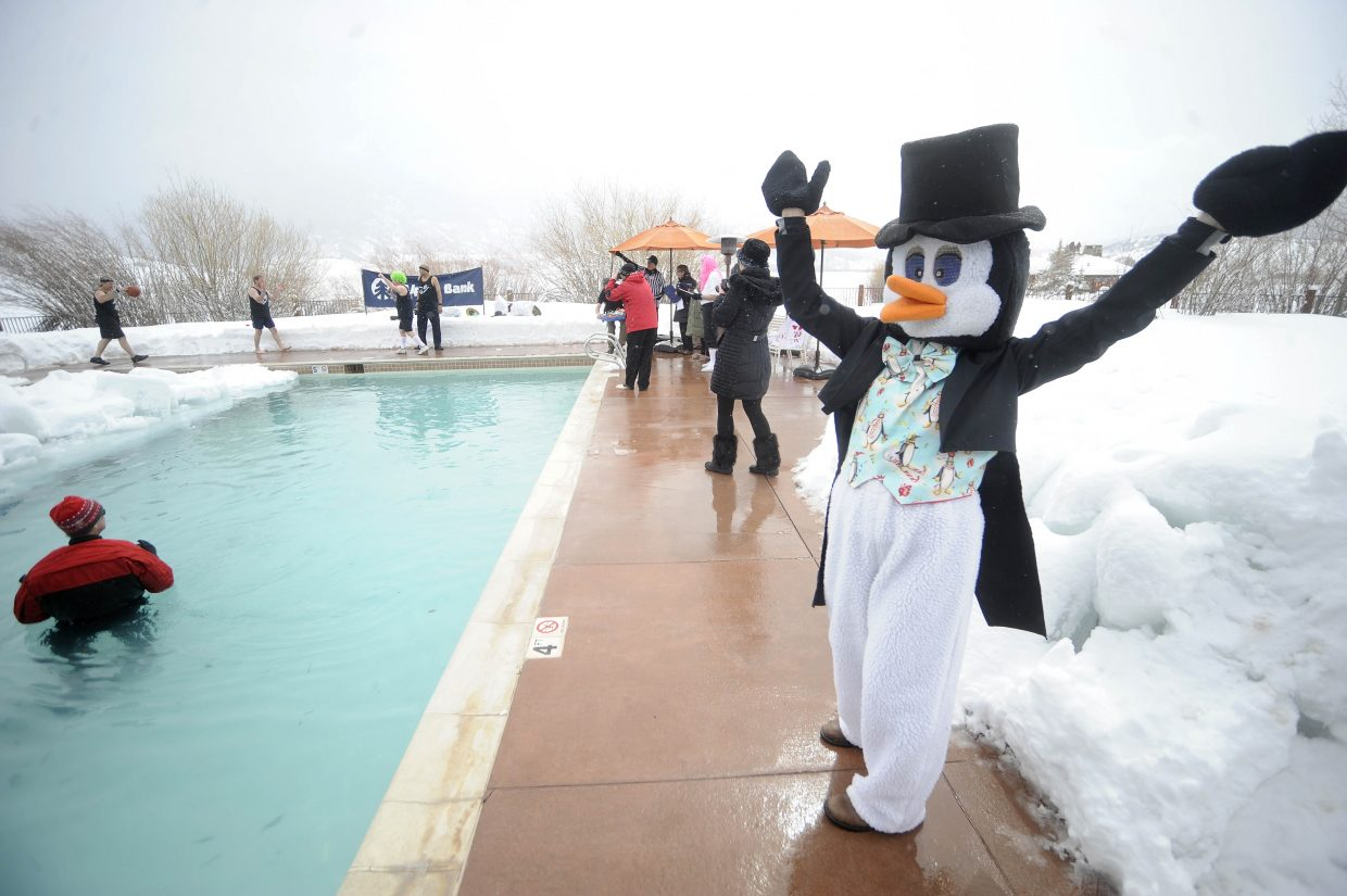 Healthcare Foundation for the Yampa Valley Executive Director Liz Finegan provides a little pep while dressed in a penguin suit during the Penguin Plunge.
