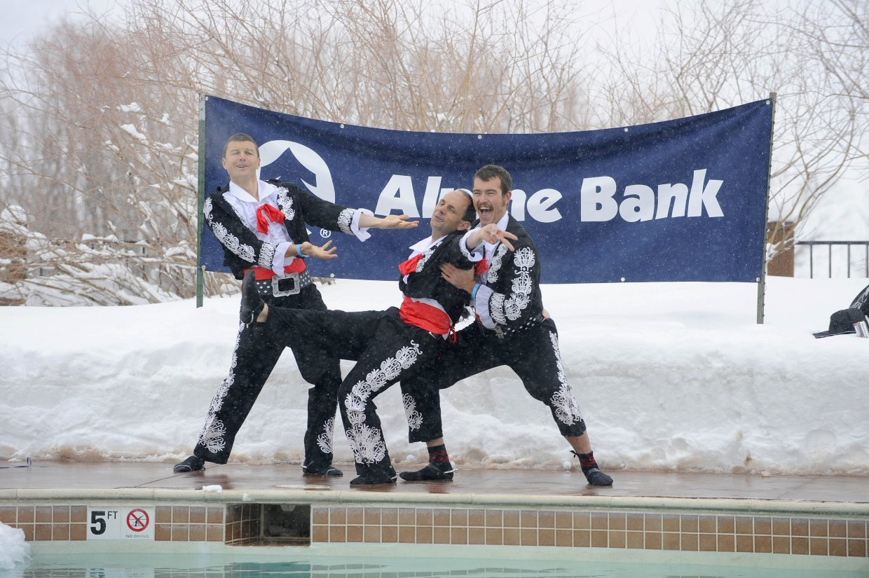 "Alpine Bank employees, from left, Adam Alspach, David High and Tom Krabacher re-enact a scene from ""Three Amigos"" during the Penguin Plunge. Benefiting YVMC's new Cancer Care Center, this year marks the 12th Annual Penguin Plunge."